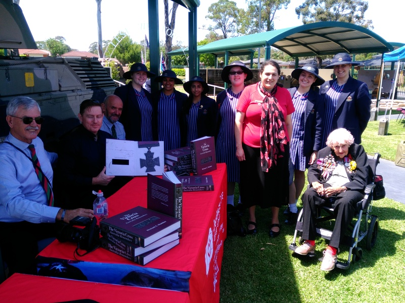 At Ingleburn RSL for the Victoria Cross Booklaunch. From LR -Doug Baird, Michael Madden, George Wheatley, Kimberly C, Neha N, Donna T, Sierra M, Mrs Musico Rullo, Lily M, Emily W, Daphe Dunne (widow of Albert Chowne VC)