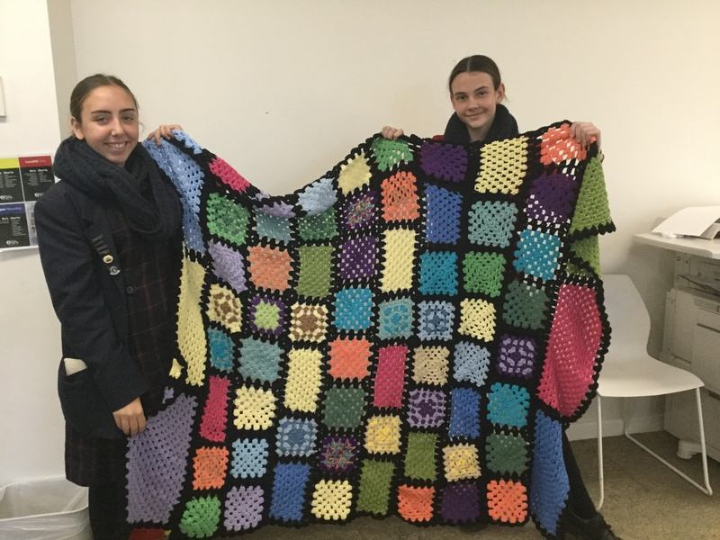 Crochet squares assembled into a blanket by Maxine Evans