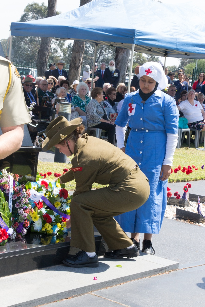 Lillian M and Fatima A laying the wreath